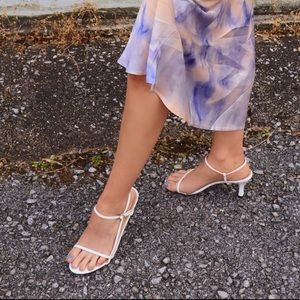 White heeled sandals